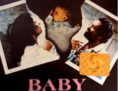 Baby Comes Home VHS sleeve features an image of a Polaroid picture split in two - the left side has a photo of a woman facing right, the right side a photo of a man facing left - between the two torn pieces is an image of a very young baby.